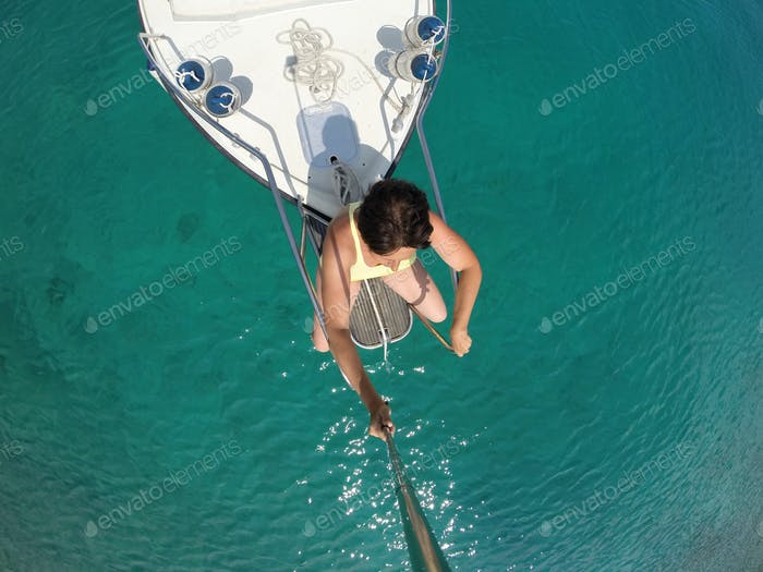 Directly Above Shot Of Woman Traveling On Boat In Adriatic Sea