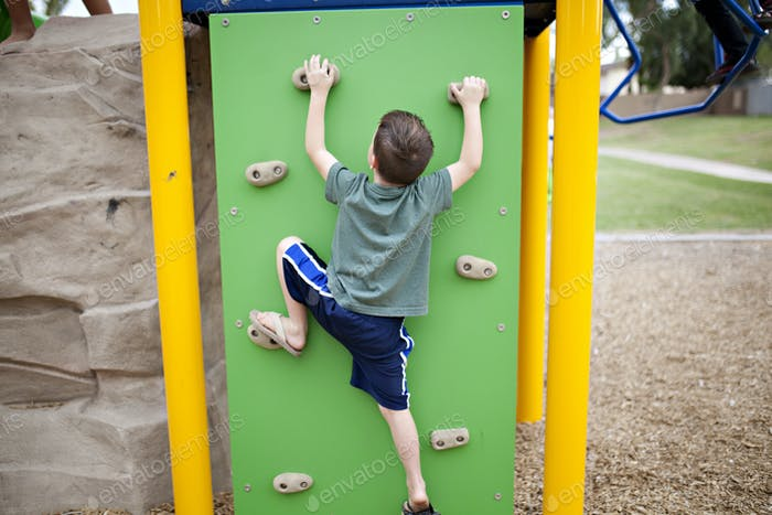 kids playing on the playground at the park