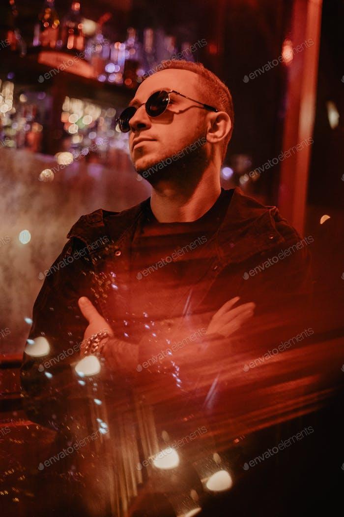 Man portrait at red city lights/night city lights