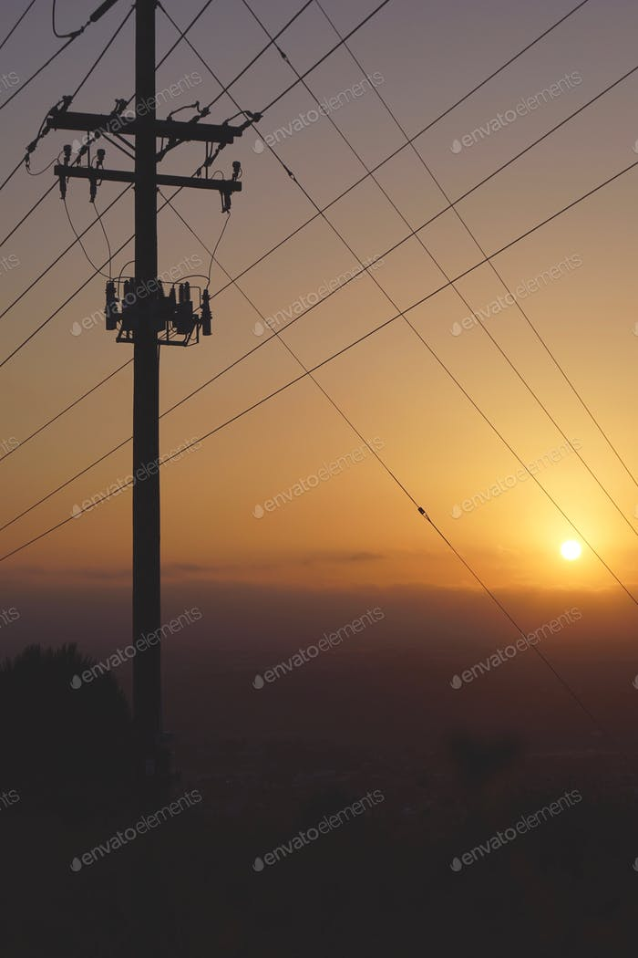Telephone pole with transformer on top of the world