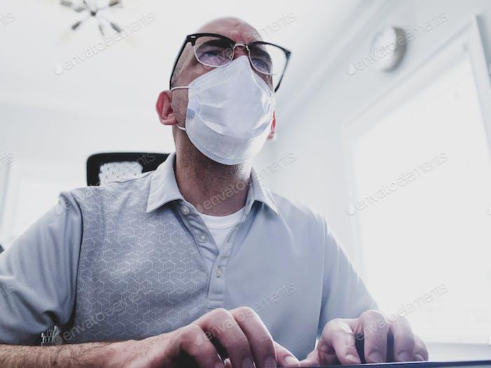 Man wearing mask at home.