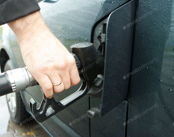 Refueling green car at the fuel pump ⛽️