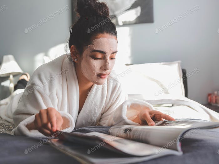 Reading a magazine in robe