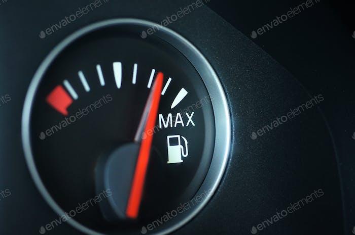 Car gas gauge closeup