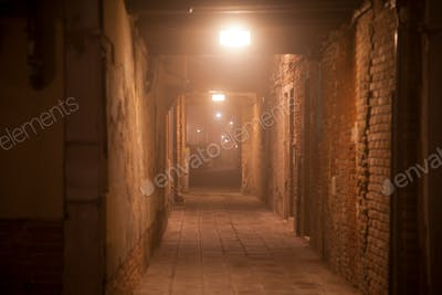 So mysterious alley into the fog, at night, mysterious Venice, Italy