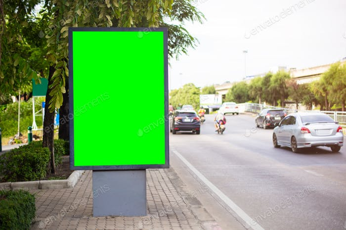 Blank billboard with chroma key green screen copy for your text on a street.