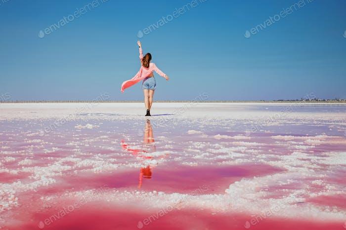 Woman on pink lake