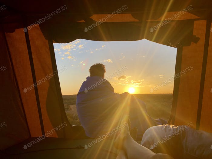 Sunrise in a tent in Australia. Camping on a 4WD
