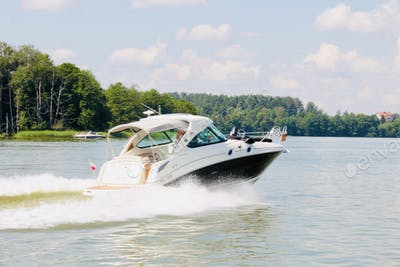 Boating, boat, lakeshore, lakeside, speed, summertime.