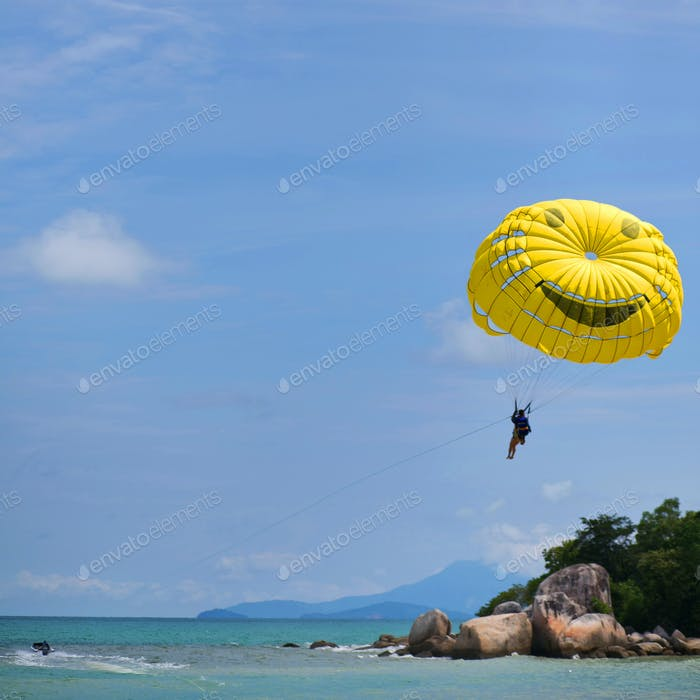 Person parasailing and motorboat