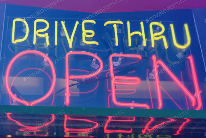 Neon sign that says drive thru open
