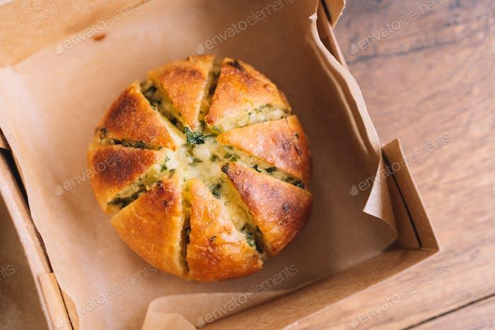Garlic Cream Cheese Bread, flat lay on wooden table