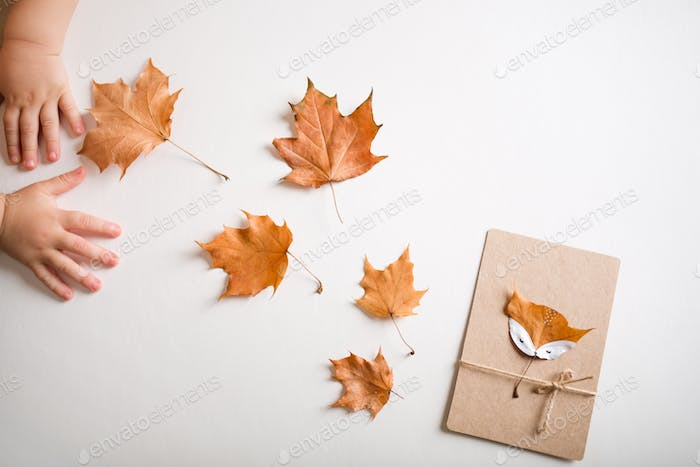 autumn craft for kids. animal Fox made from maple leaf. childrens art and creative.
