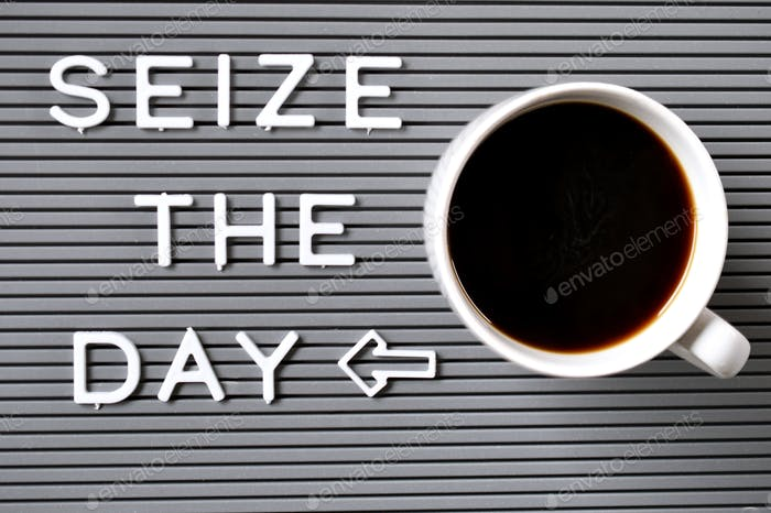 Message board saying Seize the day with coffee mug from above