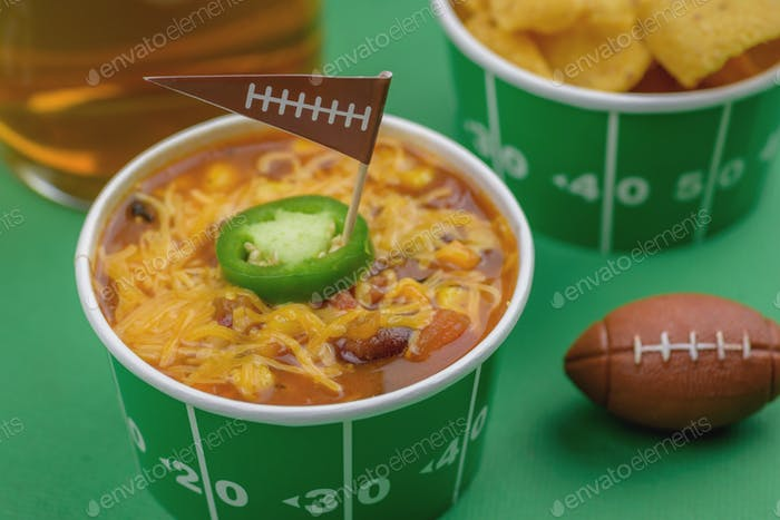 Beer and chili bowl on table for the big game party