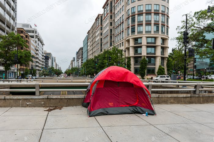 Homeless persons tent in the city  on the pedestrian walkway