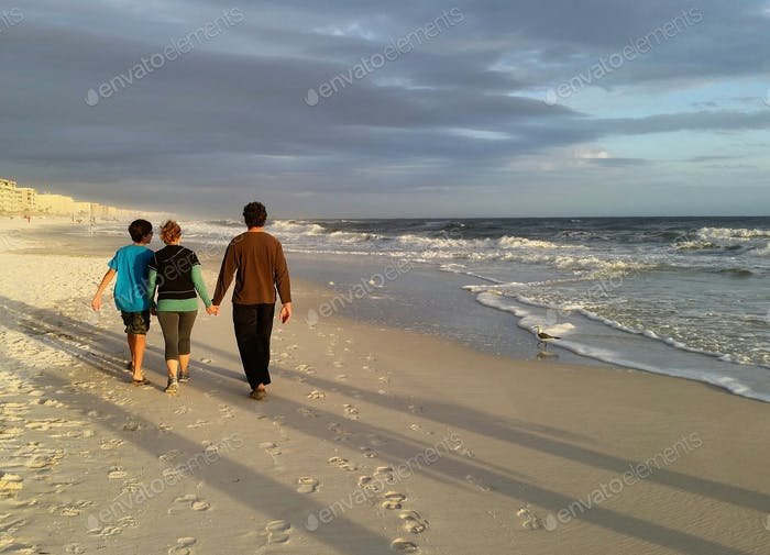 Family marching down the beach with seagull in attendance...