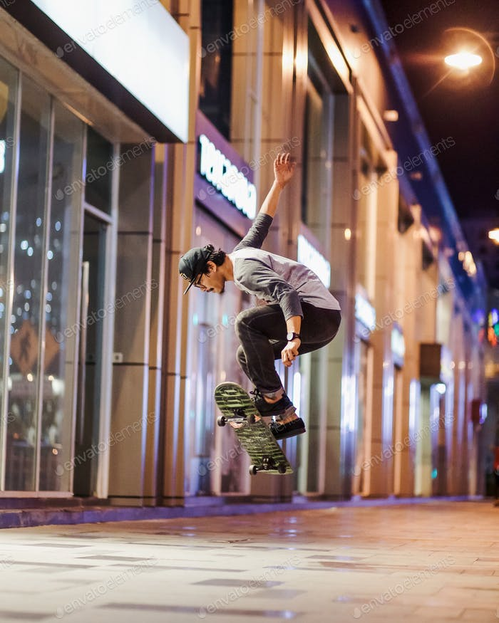 A professional skaters playing skate on street.