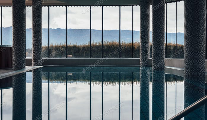 Indoor swimming pool, shapes, reflection, no people.