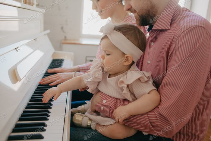 Baby girl is playing the piano