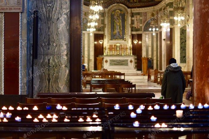A man worshiping in a church