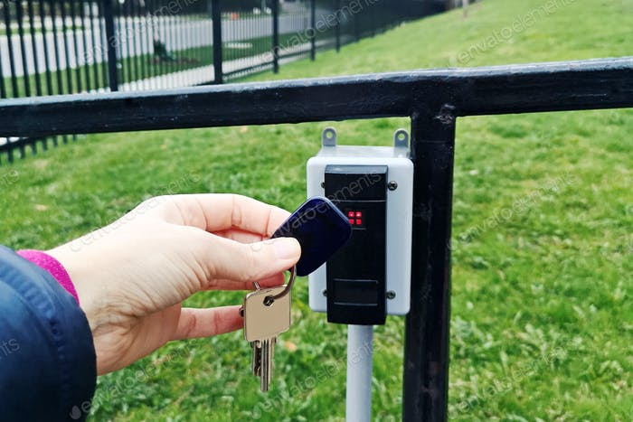 key; fob; open; door; magnetic; outdoor; device; access; outside; security; street; outside; hand;