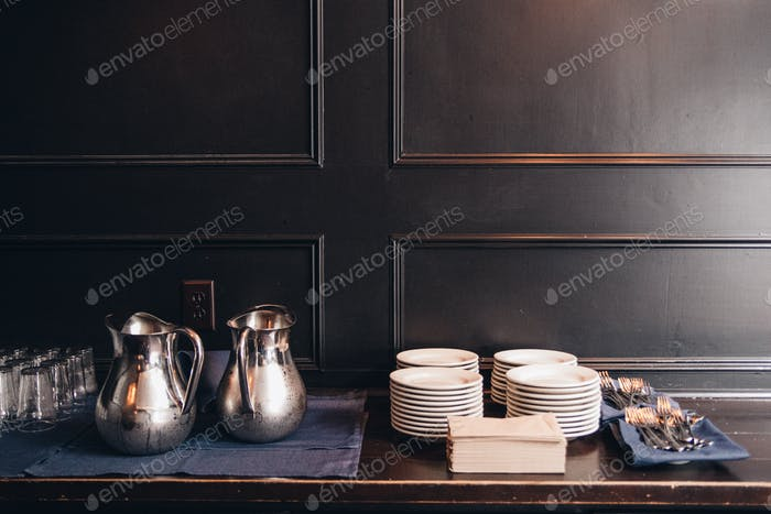 Beautiful serve ware with natural light against black wainscoting