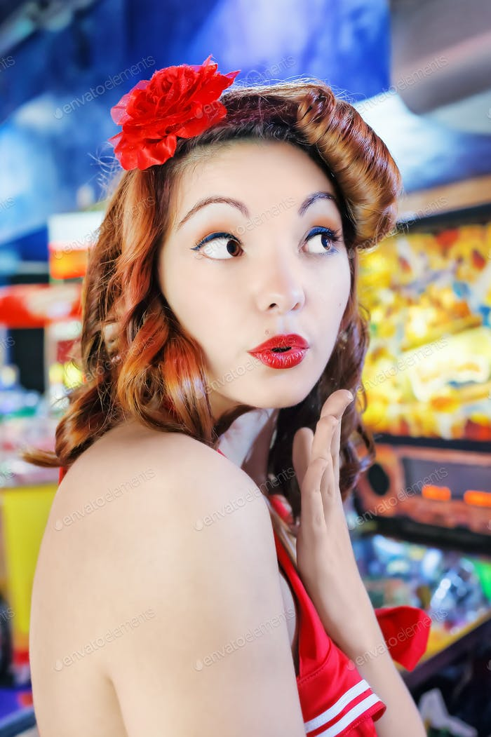 Pin-up girl kiss. Portrait of girl in pin-up style that blows a kiss.