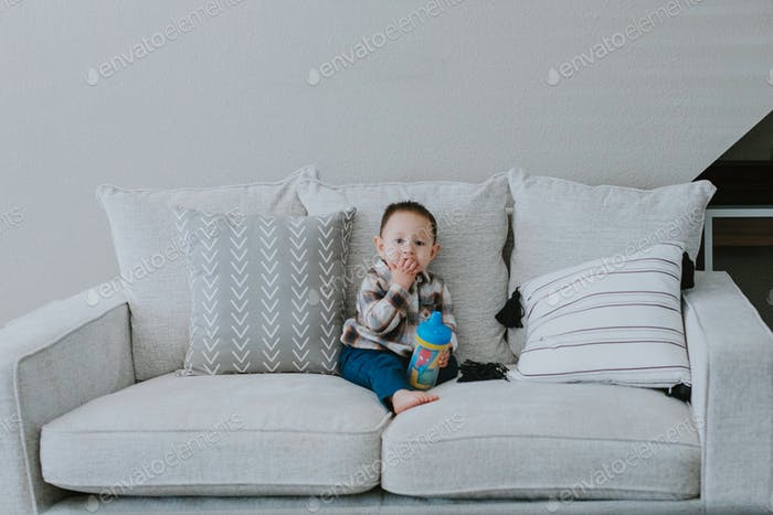 Baby boy sitting on great couch