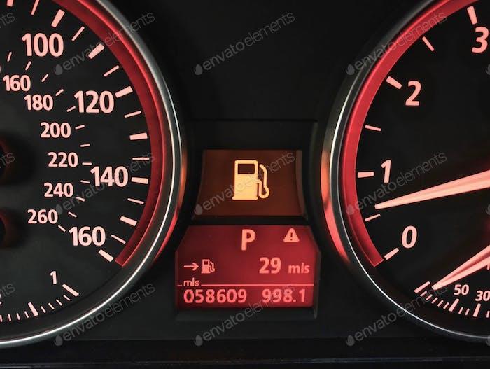 Gasoline petrol gas light on interior dashboard in car