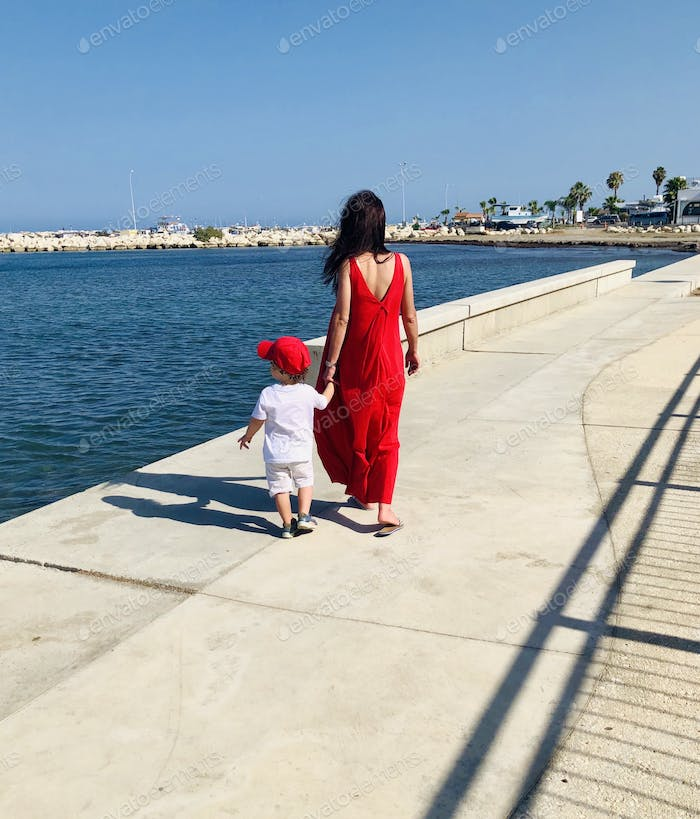 Mother holds son's hand Cyprus Larnaca