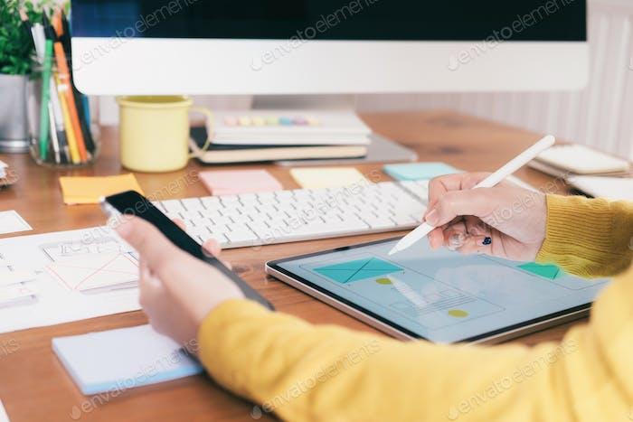 Computer software developer designing user interface.
