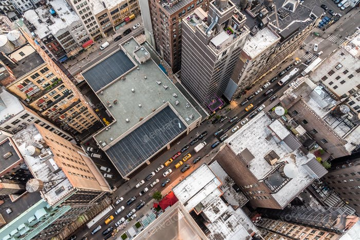 Looking down at busy 31st street in Manhattan, New York at rush hour.