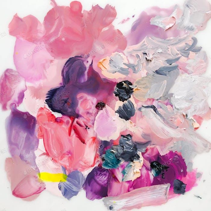 Vibrant paint smears on artist's palette.