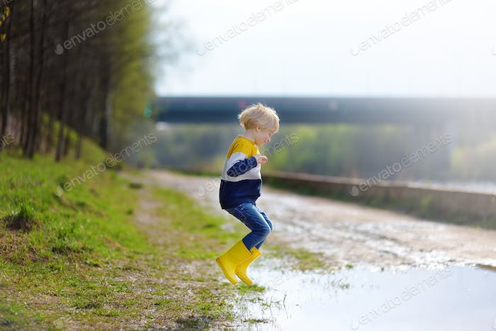 child, jumping, rain boots, yellow, jump, large, dirty, mud, puddle, fun, rain, play, mischievous, a