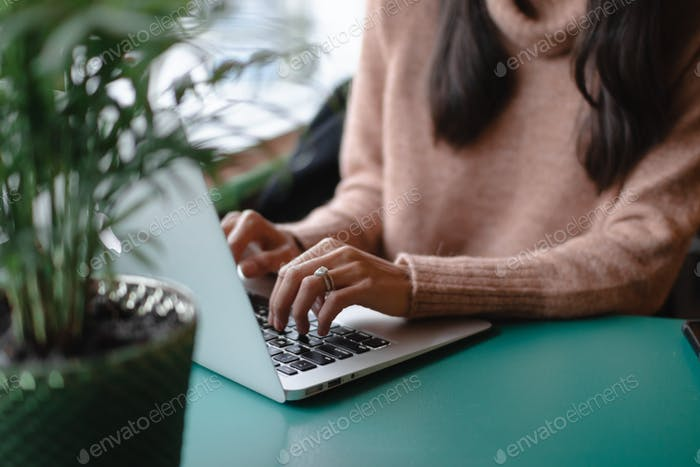 Woman working on her laptop computer
