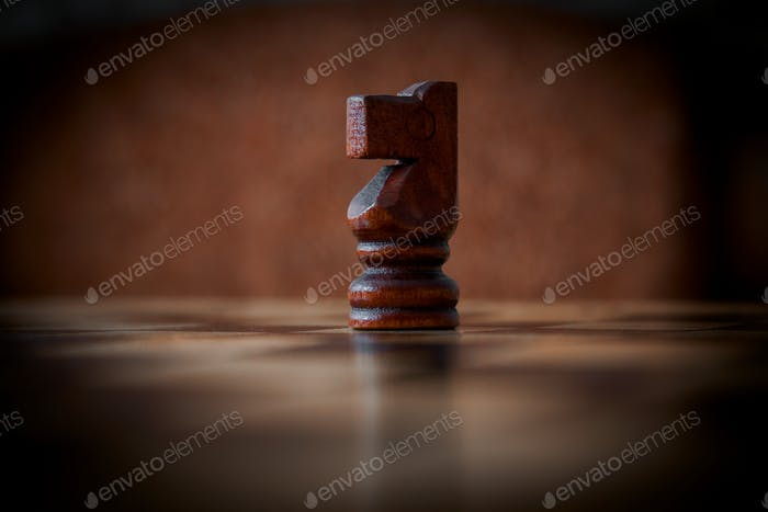 close up of a chess piece on the board, dark photo, vignette