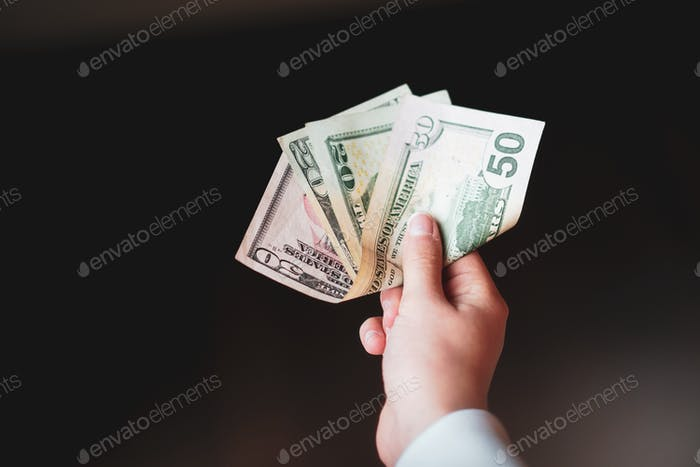 Paying cash money for goods and services