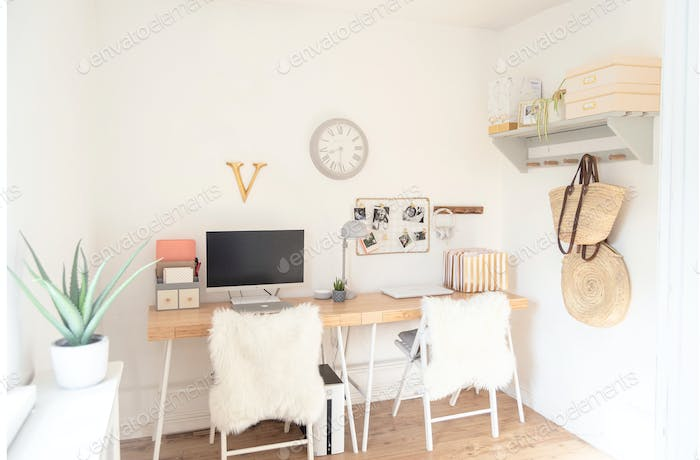 A Scandi home office with two desks side by side