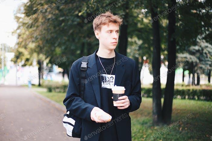 Young man, coffee break, urban life
