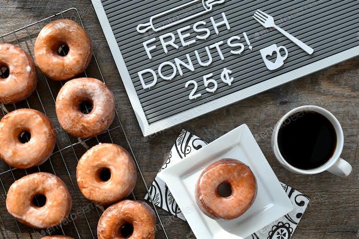 Glazed buttermilk yeast raised donuts doughnuts. breakfast food, snack, kitchen, cooking baked goods