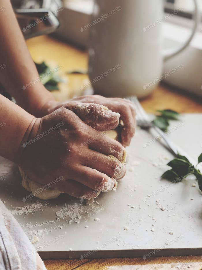 Hands Rolling Dough in a Domestic Kitchen