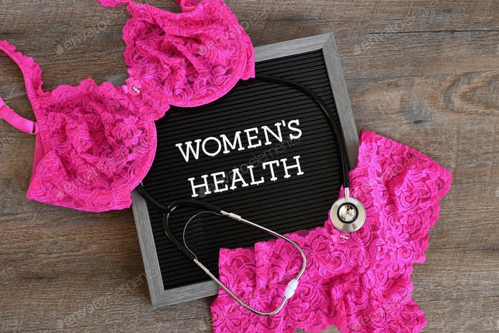 Women's Health message board sign with a stethoscope and pink lace bra and panties.