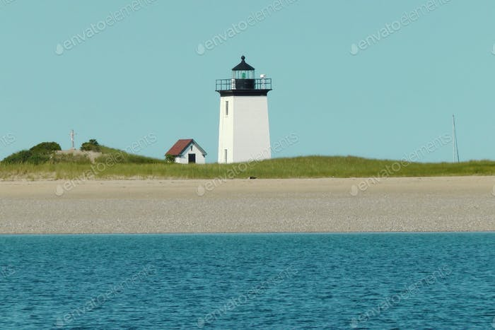 Cape cod scenery. Lighthouse on a  sandy beach     Nominated