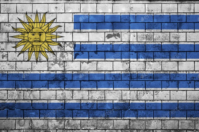 Uruguay flag is painted onto an old brick wall