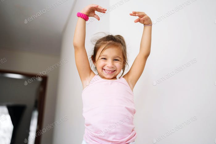 Girl posing for pictures with her hands up