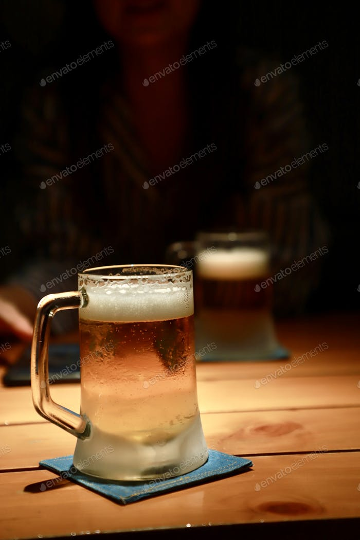 Beer in a cold glass at night party