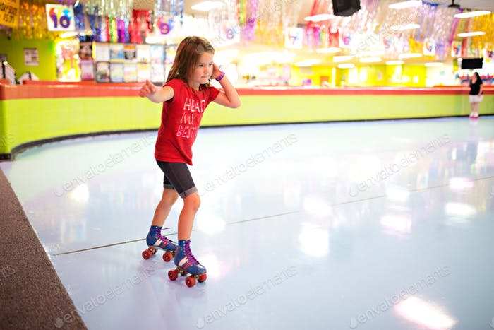 Family roller skating at a roller rink