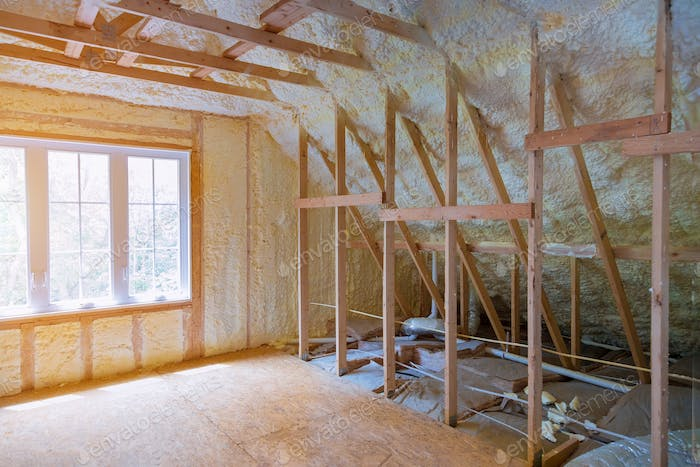 Thermal insulation a new house under the roof of air conditioner vents in new home construction on