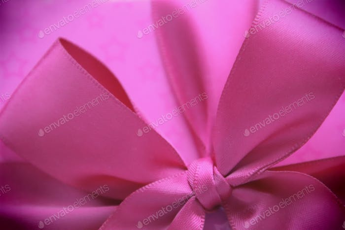 Pink satin bow on a gift